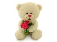Игрушка мягкая Медведь блестящий с букетом (муз.) 22 см